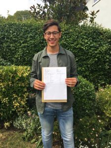 A-Level student celebrating his A* results through Expert Tuition
